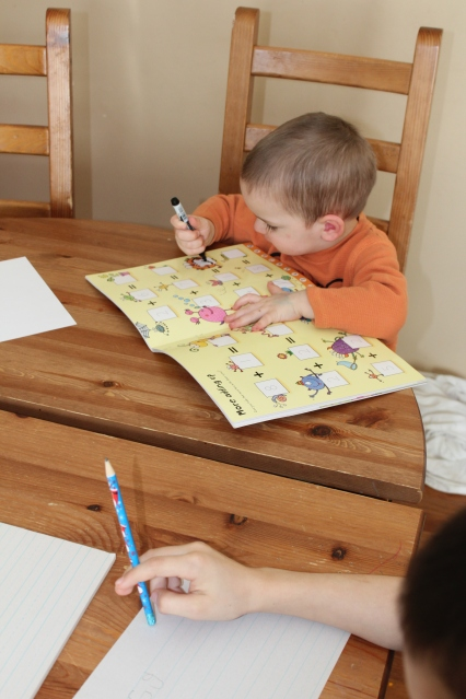 Oliver drawing on the book..and himself